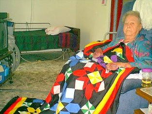 mom & her quilt #1